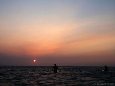 Paddleboarding during sunset in Roatan Island, Honduras