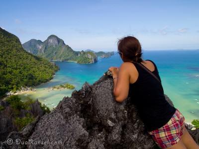 Cliff climbing Taraw Mountain, El Nido, Philippines. Looking at Cadlao Island
