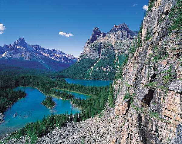 Rocky mountain cliffs and Lake O'Hara in Yoho National Park. (Photo credit: Tourism BC/JF Bergeron)