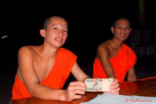 Laos - Luang Prabang - Monk Novice Khao and 1000 rupiah