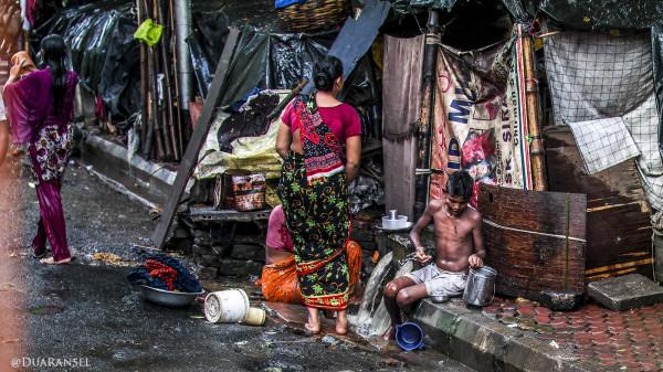 washing in sidewalk. Kolkata