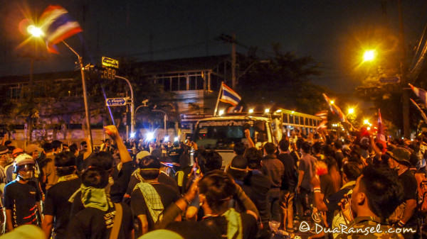 Tension between bangkok protesters and riot police