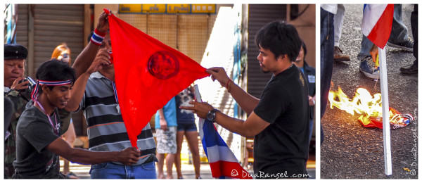 Protesters burning the red shirts flag.