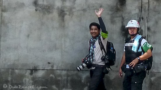 Reporters and journalists wearing body armor and helmet during Bangkok Protest
