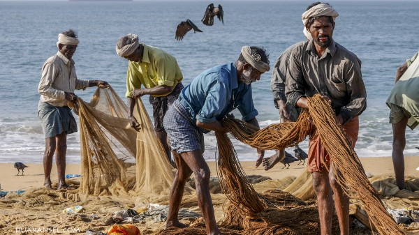 Indian fishermen at Kollam Beach, India